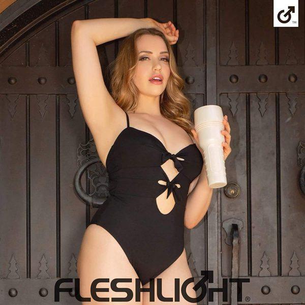 Mia Malkova posing with her fleshlight wearing a black corest