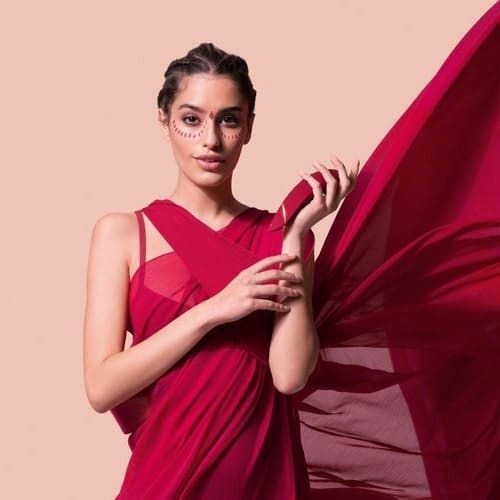 a woman in red holding Womanizer Premium